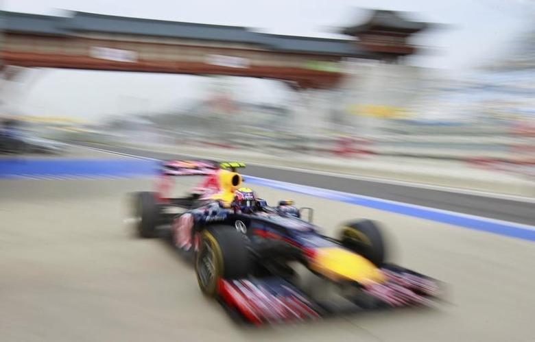 Red Bull Formula One driver Mark Webber of Australia drives in the pitlane during the third practice session of the South Korean F1 Grand Prix at the Korea International Circuit in Yeongam October 13, 2012. REUTERS/Lee Jae-Won/Files
