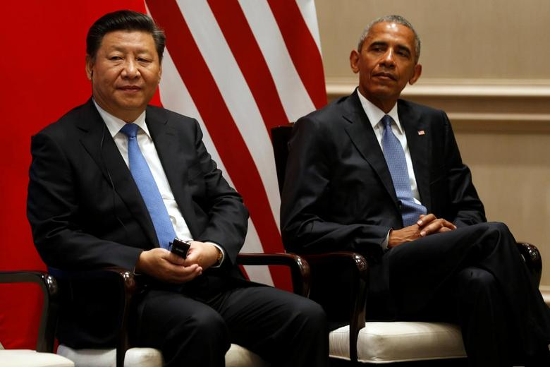 China's President Xi Jinping (L) and U.S. President Barack Obama participate in a Paris Agreements climate event ahead of the G20 Summit, at West Lake State Guest House in Hangzhou, China September 3, 2016. REUTERS/Jonathan Ernst