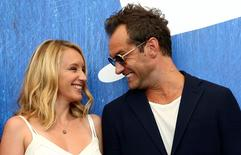 "Actor Jude Law (R) chats with actress Ludivine Sagnier as they attend the photocall for the movie ""The Young Pope"" at the 73rd Venice Film Festival in Venice, Italy September 3, 2016. REUTERS/Alessandro Bianchi"