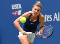 Sept 3, 2016; New York, NY, USA;    Simona Halep of Romania hits to Timea Babos of Hungary on day six of the 2016 U.S. Open tennis tournament at USTA Billie Jean King National Tennis Center. Mandatory Credit: Robert Deutsch-USA TODAY Sports
