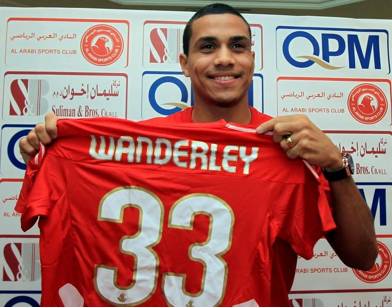 Wanderley Santos Monteiro Junior of Brazil poses for a picture with his Al-Arabi club soccer team jersey in Doha July 10, 2011. Wanderley signed a three-year contract with Al-Arabi. REUTERS/Stringer (QATAR - Tags: SPORT SOCCER) - RTR2OQ7W