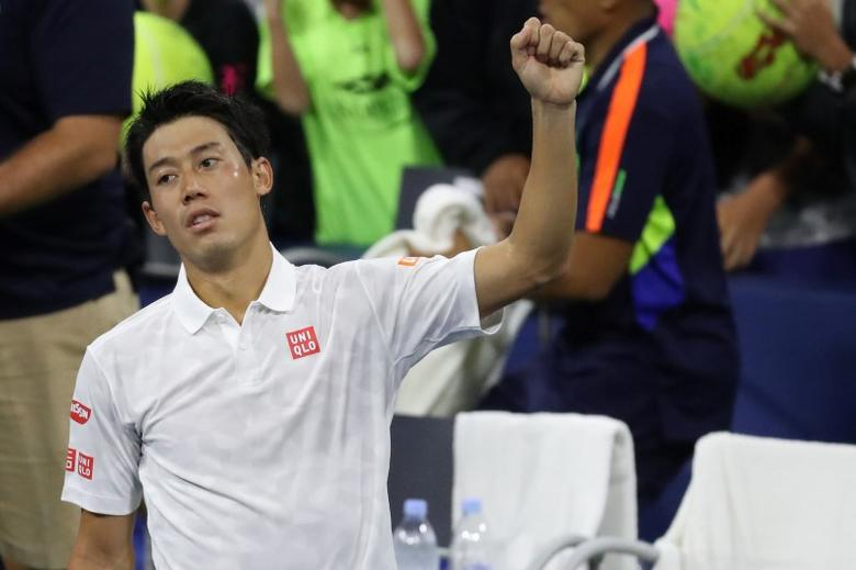 Sep 3, 2016; New York, NY, USA; Kei Nishikori of Japan waves to the crowd after his match against Nicolas Mahut of France (not pictured) on day six of the 2016 U.S. Open tennis tournament at USTA Billie Jean King National Tennis Center. Nishikori won 4-6, 6-1, 6-2, 6-2. Mandatory Credit: Geoff Burke-USA TODAY Sports