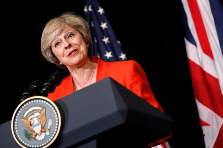 Britain's Prime Minister Theresa May answers a reporter's question after a bilateral meeting with U.S. President Barack Obama alongside the G20 Summit, in Ming Yuan Hall at Westlake Statehouse in Hangzhou, China September 4, 2016. REUTERS/Jonathan Ernst