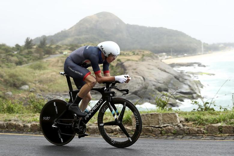 Chris Froome of United Kingdom competes in men's cycling time trial. REUTERS/Bryn Lennon/Pool