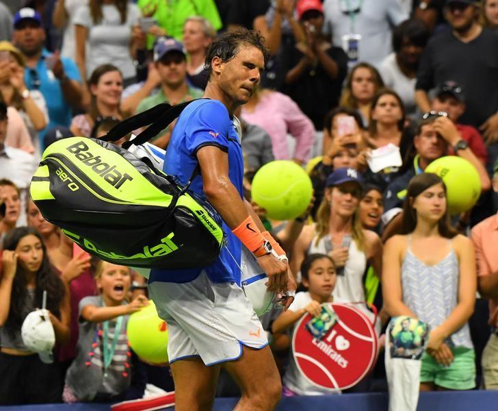 Sept 4, 2016; New York, NY, USA;     Rafael Nadal of Spain after losing to Lucas Pouille of France on day seven of the 2016 U.S. Open tennis tournament at USTA Billie Jean King National Tennis Center. Mandatory Credit: Robert Deutsch-USA TODAY Sports