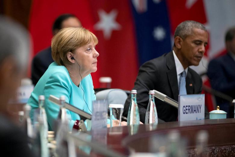 German Chancellor Angela Merkel (L) and U.S. President Barack Obama (R) attend the G20 Summit in Hangzhou, Zhejiang province, China, September 4, 2016. REUTERS/Mark Schiefelbein/Pool