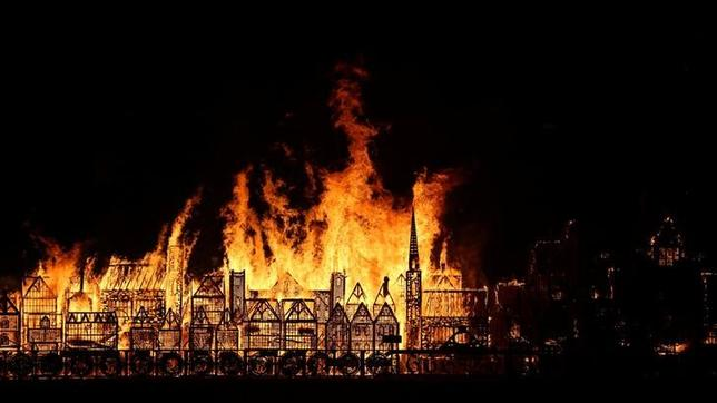 A 120-meter long model of the 17th century London skyline is set alight on the River Thames to commemorate the 1666 Great Fire of London in London, Britain, September 4, 2016. REUTERS/Neil Hall