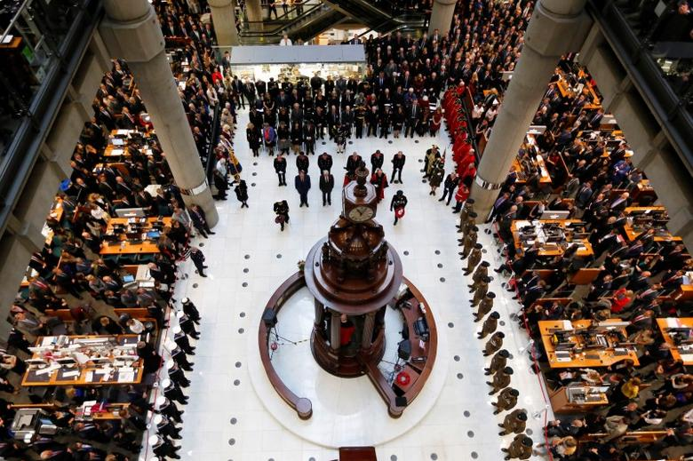 Lloyd's of London staff hold their annual Remembrance Day service at the Lloyd's building in the City of London, Britain November 11, 2015.  REUTERS/Stefan Wermuth