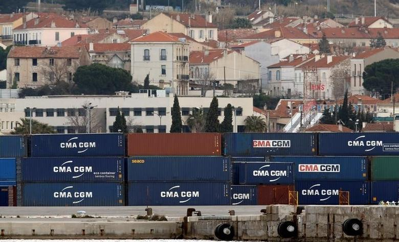 Shipping containers belonging to CMA-CGM shipping Company are seen stacked in the port of Marseille, France, March 14, 2016.   REUTERS/Jean-Paul Pelissier/File Photo
