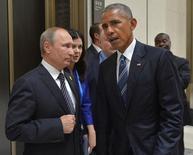 Президент России Владимир Путин (слева) и президент США Барак Обама в кулуарах саммита G20 в Ханчжоу, Китай, 5 сентября 2016 года. Взрывы в контролируемых силами президента Башара Асада провинциях Сирии и в удерживаемых курдами районах унесли десятки жизней в понедельник, когда США и Россия не смогли договориться о шагах в направлении перемирия. Sputnik/Kremlin/Alexei Druzhinin/via REUTERS