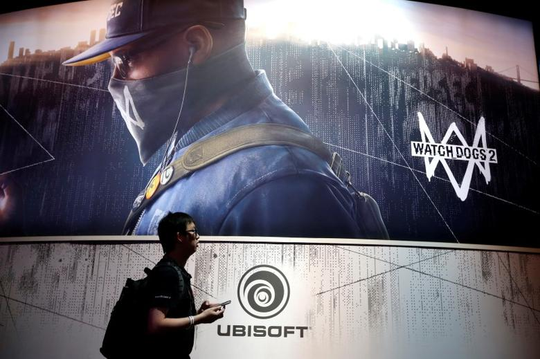 A man walks past the Ubisoft booth at the E3 Electronic Expo in Los Angeles, California, U.S. June 14, 2016. REUTERS/Lucy Nicholson