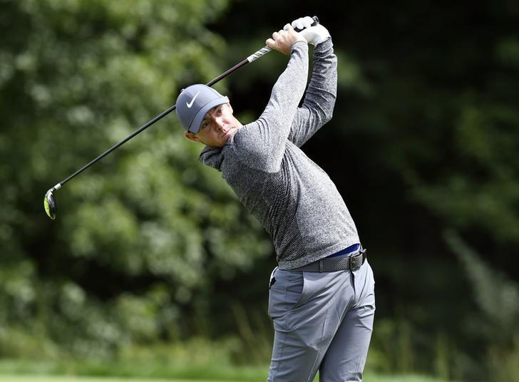 Sep 5, 2016; Norton, MA, USA;  Rory McIlroy hits his tee shot on the 14th hole during the final round of the 2016 Deutsche Bank Championship golf tournament at TPC of Boston. Mandatory Credit: Mark Konezny-USA TODAY Sports