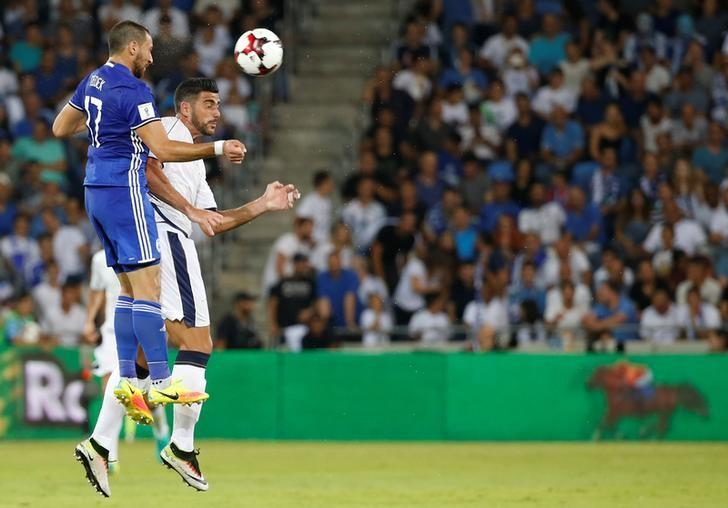 Football Soccer - Israel v Italy - World Cup 2018 Qualifiers - Sammy Ofer Stadium, Haifa, Israel - 05/09/16. Graziano Pelle of Italy competes for the ball with Shir Tzedek of Israel. REUTERS/Baz Ratner