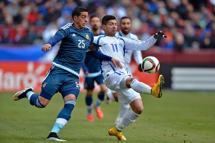 Mar 28, 2015; Landover, MD, USA; El Salvador forward Nelson Bonilla (11) plays the ball in front of Argentina defender Ramiro Funes-Mori (25) during the first half at FedEx Field. Mandatory Credit: Tommy Gilligan-USA TODAY Sports