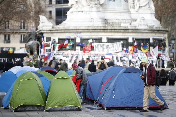 The tents of migrants are seen at the site of the Paris attacks memorial near the statue at the Place de la Republique in Paris, France, January 6, 2016.  REUTERS/Charles Platiau/Files