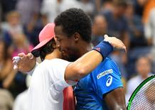 Sept 6, 2016; New York, NY, USA;  Gael Monfils (r) of France greets Lucas Pouille of France after their match on day nine of the 2016 U.S. Open tennis tournament at USTA Billie Jean King National Tennis Center. Mandatory Credit: Robert Deutsch-USA TODAY Sports