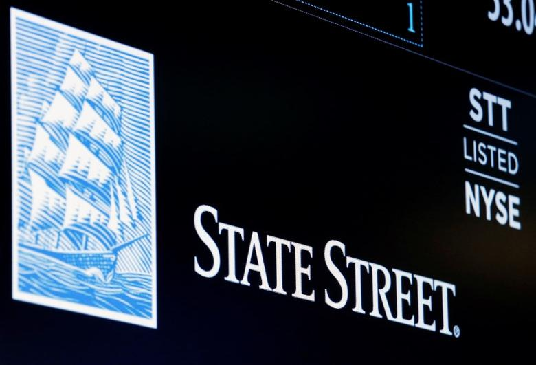 The ticker and logo for State Street Corporation is displayed on a screen at the post where it's traded on the floor of the New York Stock Exchange (NYSE) in New York City, U.S., June 30, 2016.  REUTERS/Brendan McDermid
