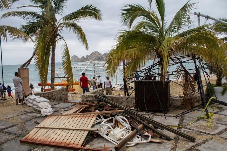 Residents stand next to debris of a restaurant in the aftermath of Hurricane Newton in Los Cabos, Mexico, September 6, 2016. REUTERS/Fernando Castillo