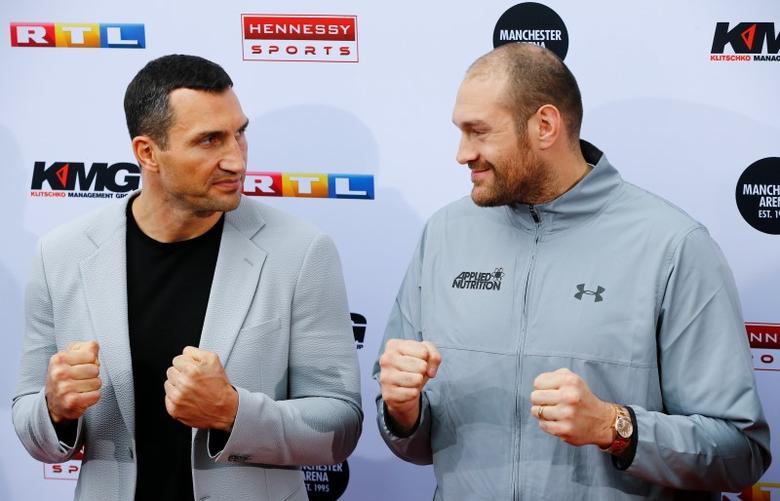 Boxing - Vladimir Klitschko and Tyson Fury News Conference - Cologne, Germany - 28/4/16 - Vladimir Klitschko and Tyson Fury at a news conference  REUTERS/Wolfgang Rattay
