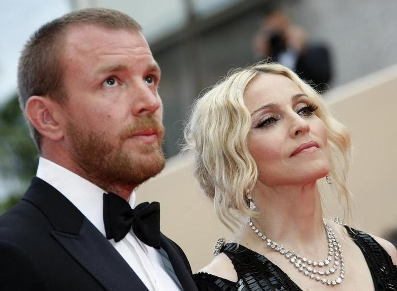 Singer Madonna and director husband Guy Ritchie arrive on the red carpet at the 61st Cannes Film Festival in this May 21, 2008 file photo. REUTERS/Eric Gaillard/Files