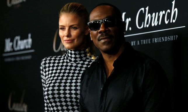 Cast member Eddie Murphy and his partner Paige Butcher pose at the premiere of ''Mr. Church'' in Los Angeles, California U.S., September 6, 2016.   REUTERS/Mario Anzuoni