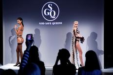 Attendees watch as models present creations from God Save Queens Spring/Summer 2017 collection during New York Fashion Week in the Manhattan borough of New York, U.S., September 7, 2016.  REUTERS/Lucas Jackson