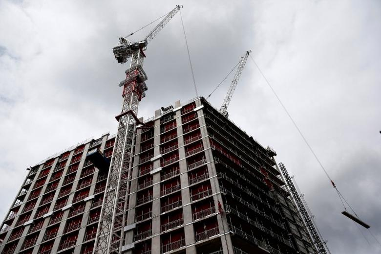 A crane towers over a building site in central London, Britain June 27, 2016. REUTERS/Neil Hall