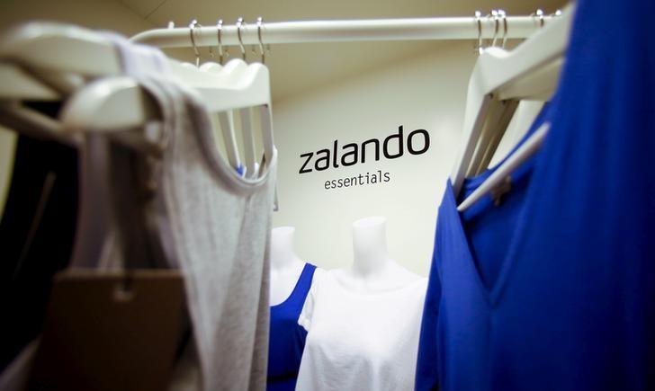 A Zalando logo is seen printed on a wall in a showroom of the fashion retailer Zalando in Berlin, October 14, 2014.  REUTERS/Hannibal Hanschke/Files