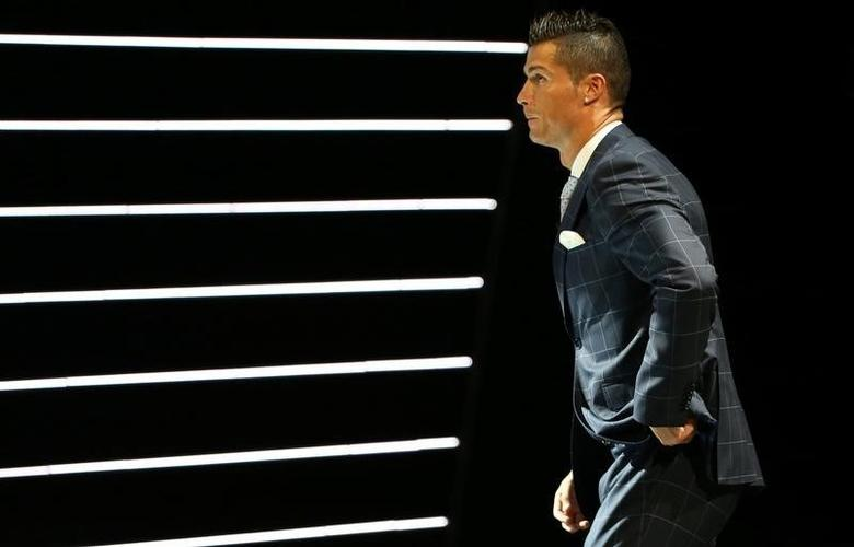 Real Madrid's Cristiano Ronaldo of Portugal arrives on the stage to receive The Best Player UEFA 2015/16 Award during the draw ceremony for the 2016/2017 Champions League Cup soccer competition at Monaco's Grimaldi in Monaco, August 25, 2016. REUTERS/Eric Gaillard