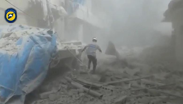 A still image taken on September 7, 2016 from a video posted on social media said to be shot in Aleppo's Al Sukari on September 6, 2016, shows a civil defense member making his way through debris, after a suspected chlorine gas attack, Syria. Social Media via Reuters TV