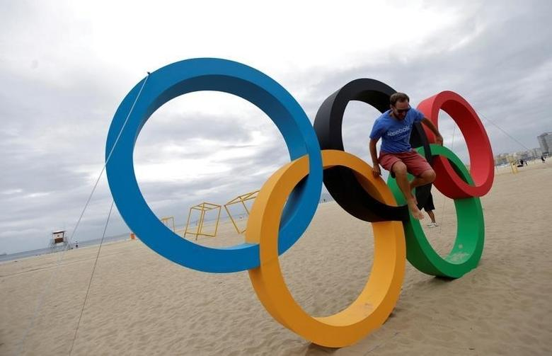 A tourist jumps after posing with the Olympic Rings after its inauguration ceremony in Copacabana Beach ahead 2016 Rio Olympics in Rio de Janeiro, Brazil, July 21, 2016. REUTERS/Ricardo Moraes/File Photo