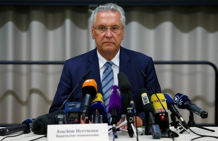 Bavarian Interior Minister Joachim Herrmann addresses a news conference after an explosion in Ansbach, near Nuremberg, Germany July 25, 2016.   REUTERS/Michaela Rehle