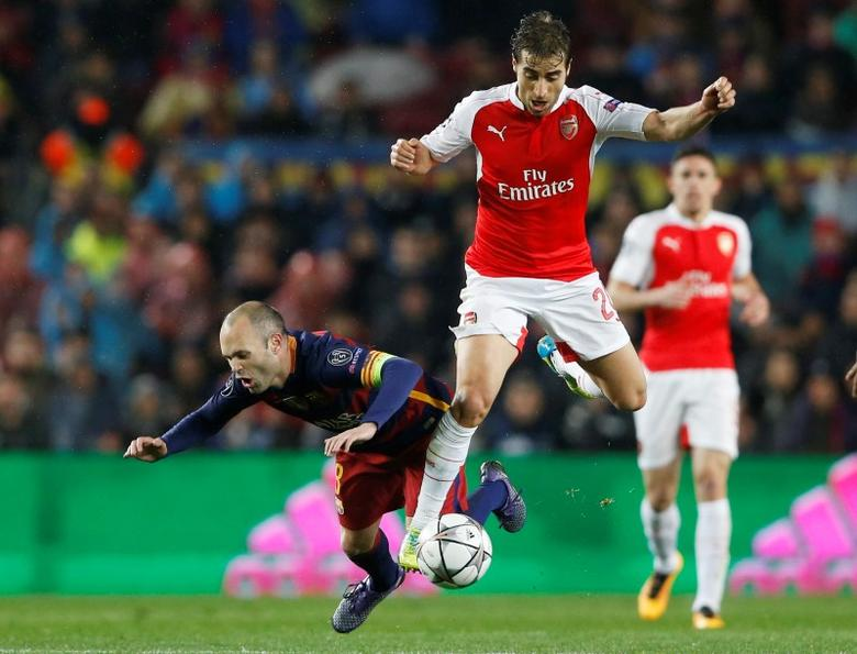 Football Soccer - FC Barcelona v Arsenal - UEFA Champions League Round of 16 Second Leg - The Nou Camp, Barcelona, Spain - 16/3/16Arsenal's Mathieu Flamini in action with Barcelona's Andres IniestaAction Images via Reuters / Carl RecineLivepicEDITORIAL USE ONLY. - RTSAS1X