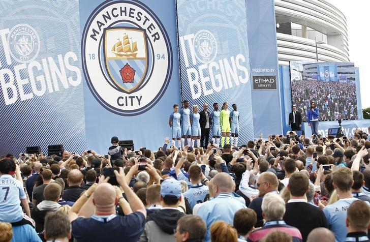 Britain Football Soccer - Pep Guardiola presented to Manchester City fans - City Academy Stadium - 3/7/16. Manchester City manager Pep Guardiola is presented to the fans with Kelechi Iheanacho and Steph Houghton. Action Images via Reuters / Craig Brough. Livepic/Files
