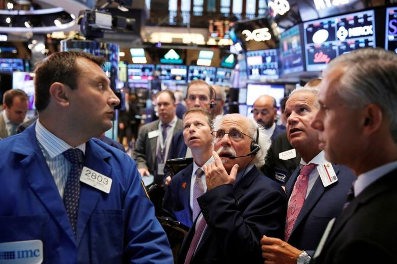 Traders work on the floor of the New York Stock Exchange (NYSE) shortly after the opening bell in New York, U.S., August 30, 2016.  REUTERS/Lucas Jackson/File Photo