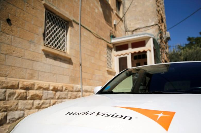 The logo of U.S.-based Christian charity World Vision is seen on a car parked outside their offices in Jerusalem August 4, 2016. REUTERS/Ammar Awad
