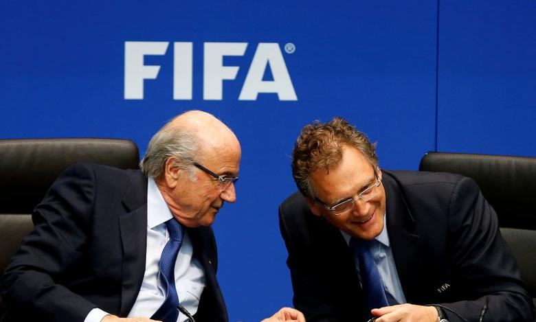 FIFA President Sepp Blatter (L) talks to FIFA Secretary General Jerome Valcke during a news conference after a meeting of the FIFA executive committee in Zurich March 21, 2014. REUTERS/Arnd Wiegmann/File Photo