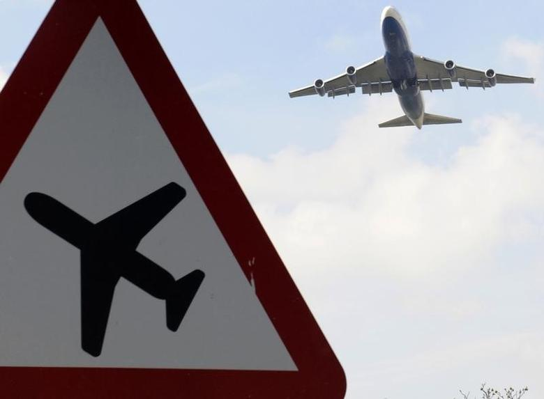 A jumbo jet takes off shortly before midday from Heathrow Airport in west London April 15, 2010.  REUTERS/Toby Melville/Files
