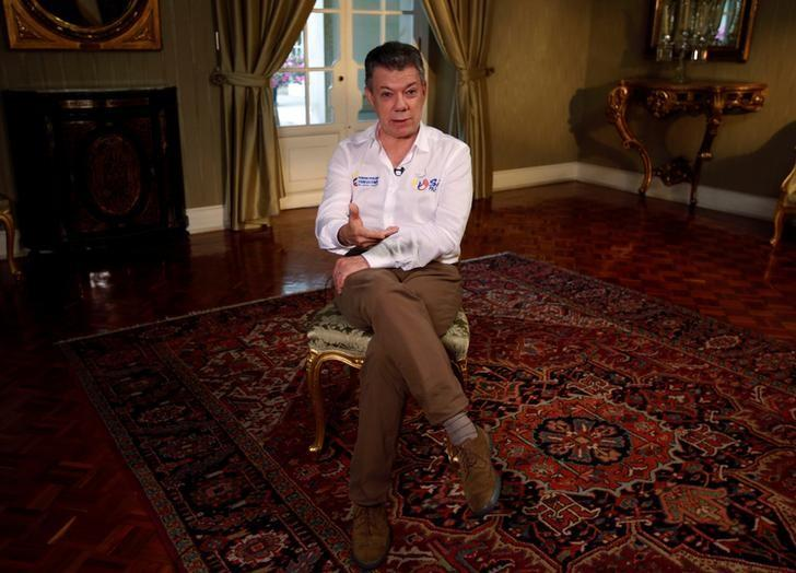 Colombia's President Juan Manuel Santos gestures during an interview with Reuters at the Narino Palace in Bogota, Colombia September 5, 2016. REUTERS/John Vizcaino