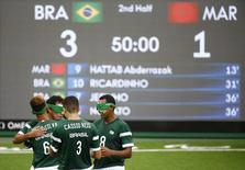 Jogadores da seleção brasileira de futebol de cinco comemoram durante partida contra Marrocos durante a Paralimpíada Rio 2016 09/09/2016 REUTERS/Ricardo Moraes