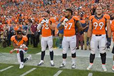 Sep 8, 2016; Denver, CO, USA; Denver Broncos inside linebacker Brandon Marshall (54) kneels during the national anthem next to defensive end Jared Crick (93) and defensive tackle Billy Winn (97) and defensive tackle Adam Gotsis (99) before the game against the Carolina Panthers at Sports Authority Field at Mile High. Ron Chenoy-USA TODAY Sports