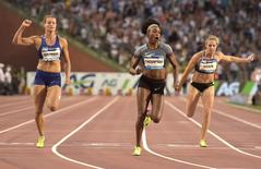 Athletics - IAAF Athletics Diamond League final - Women's 100m - King Baudouin stadium, Brussels, Belgium - 9/9/2016 - Elaine Thompson of Jamaica (C)  wins the100m women ahead of Dafne Schippers of the Netherlands (L).  REUTERS/Eric Vidal