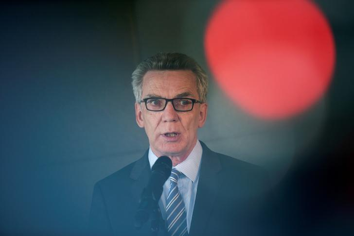 German Interior Minister Thomas de Maiziere speaks to the media after a vistit at the Facebook office in Berlin, Germany August 29, 2016. REUTERS/Stefanie Loos/Files