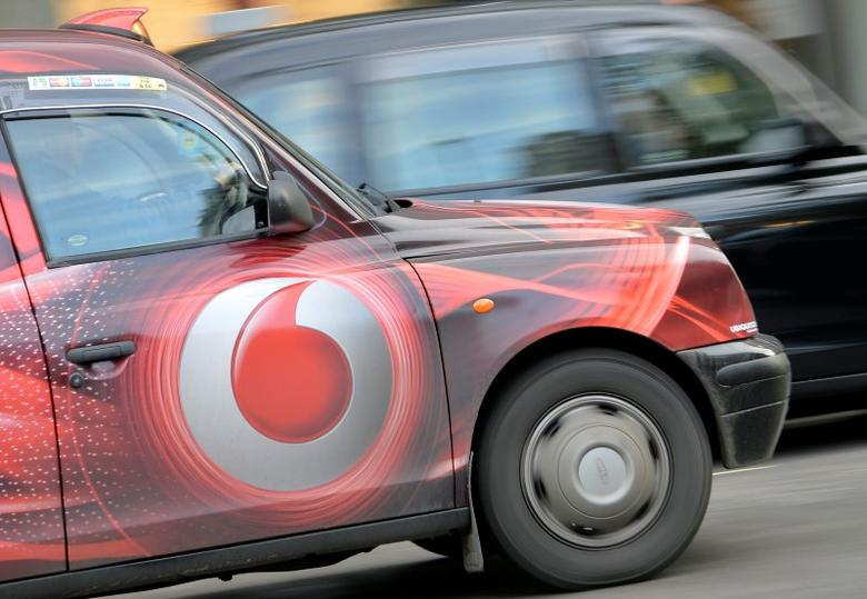 Vodafone branding is seen on the side of a London taxi in London November 12, 2013.   REUTERS/Toby Melville/File Photo - RTSJ54P