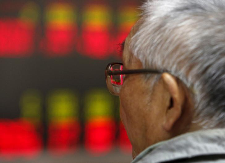 An investor watches an electronic board showing stock information at a brokerage office in Beijing, China, July 9, 2015. REUTERS/Kim Kyung-Hoon/Files