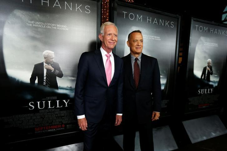 Cast member Tom Hanks (R) poses with Captain Chesley ''Sully'' Sullenberger at the premiere of ''Sully'' in Los Angeles, California U.S., September 8, 2016.   REUTERS/Mario Anzuoni