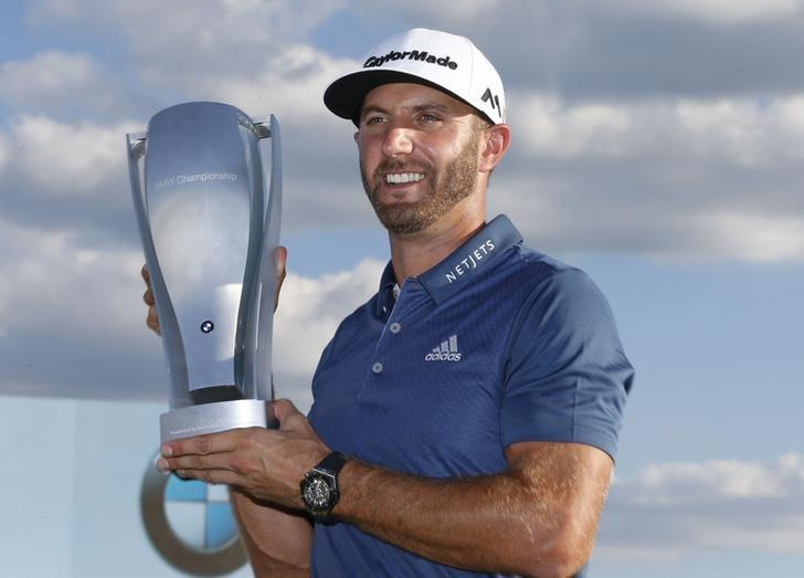 Sep 11, 2016; Carmel, IN, USA; Dustin Johnson poses with the BMW Championship Trophy after winning the BMW Championship at Crooked Stick GC. Mandatory Credit: Brian Spurlock-USA TODAY Sports