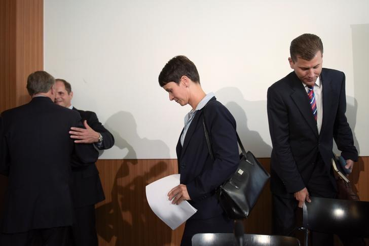 Frauke Petry, chairwoman of the anti-immigration party Alternative for Germany (AfD), and Afd spokesman Christian Lueth (R) leave a news conference in Berlin, Germany, September 5, 2016. REUTERS/Stefanie Loos