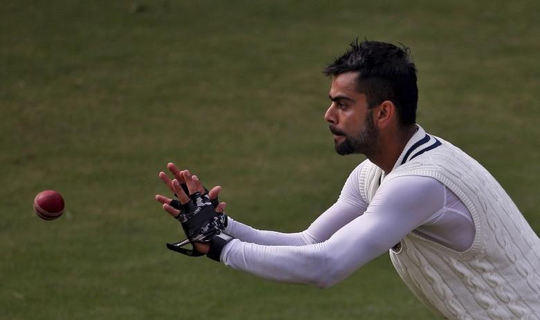 India's captain Virat Kohli prepares to catch the ball during a practice session ahead of their fourth and final test cricket match against South Africa, in New Delhi, India, December 2, 2015. REUTERS/Anindito Mukherjee/File Photo