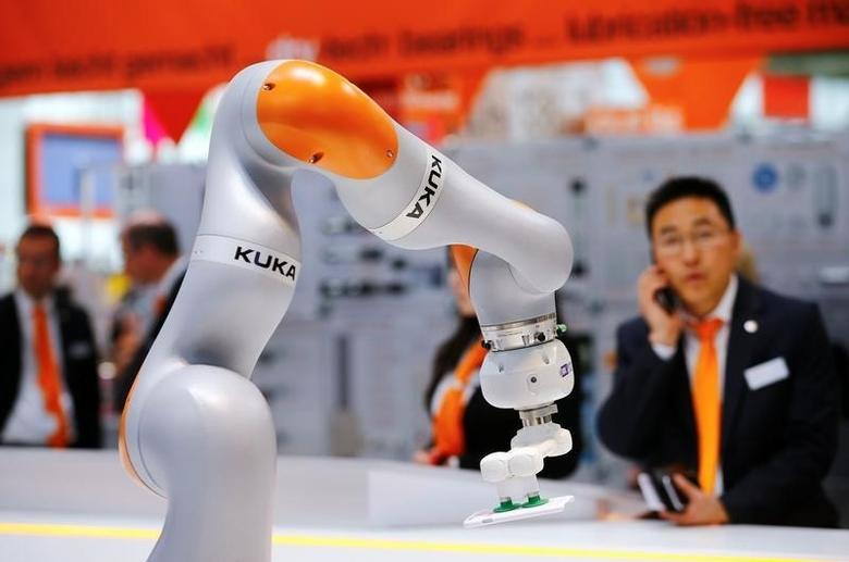 china_dealbook_china_acquisition_media_kuka_industrial_robot